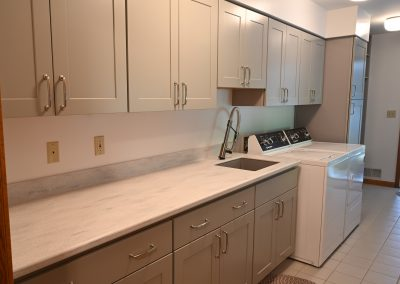 Laundry room with Corian countertops